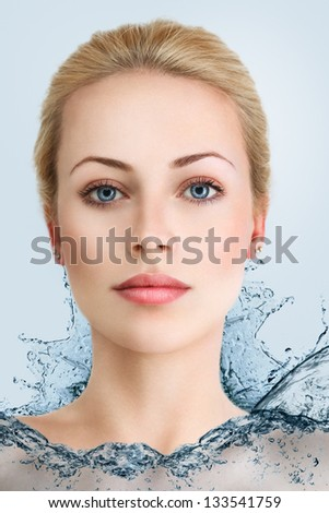 Young beautiful blonde woman in water dress - stock photo