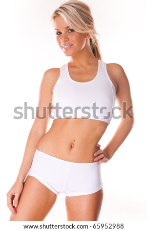 Young beautiful blonde woman in white fitness clothing - stock photo