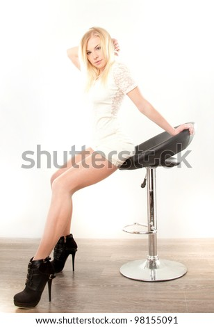 young beautiful blonde woman sitting on the chair
