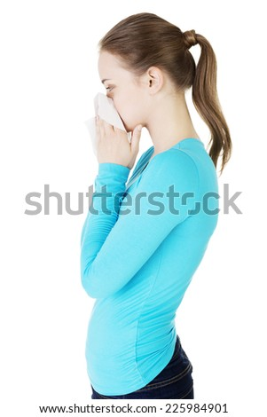 Young beautiful blonde woman sneezing - stock photo