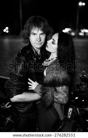 young, beautiful, bold, sexy, spectacular, charming, Young beautiful sexy couple, love, passione, namored, man and woman, biker and girlfriend, prostitute and bachelor. Black and white photo. Stylish - stock photo