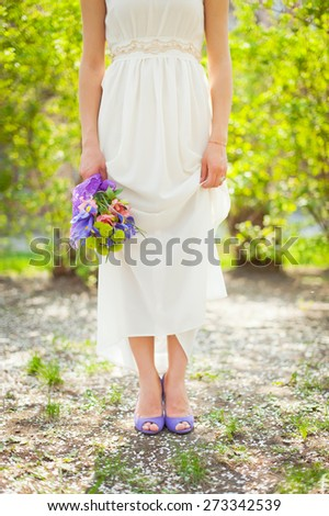 Young beautiful bride with a wedding bouquet. Purple wedding. - stock photo