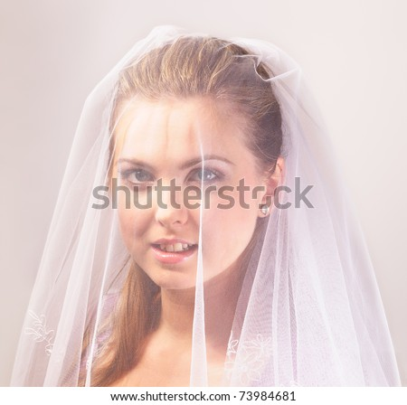 Young beautiful bride with the veil - stock photo