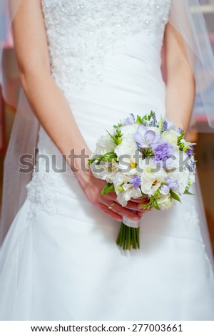 Young beautiful bride with wedding bouquet. Just married . - stock photo