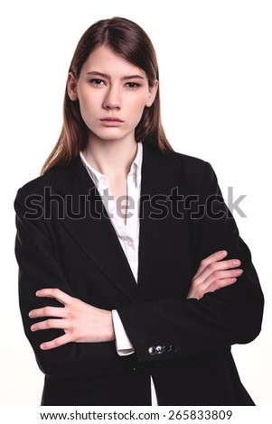 Young Beautiful Brunette Businesswoman/Student standing arms crossed - stock photo