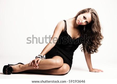 young beautiful brunette elegant woman studio shot - stock photo