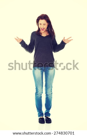 Young beautiful brunette woman cheering - stock photo