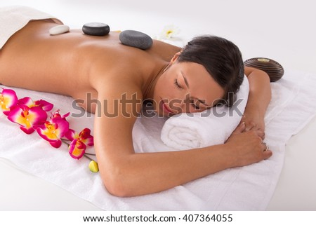 Young beautiful brunette woman getting spa procedures.