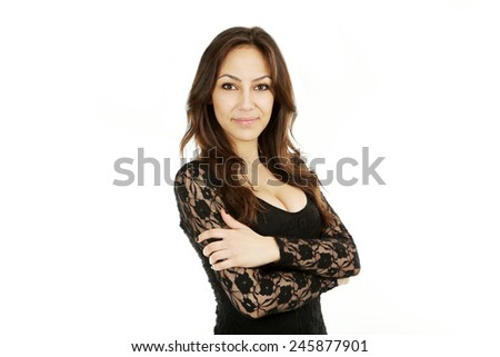 Young beautiful brunette woman in black dress on white background - stock photo