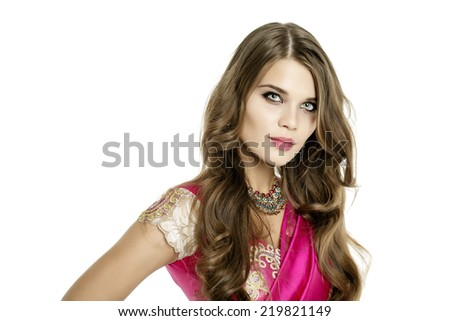 Young beautiful brunette woman in indian dress - stock photo