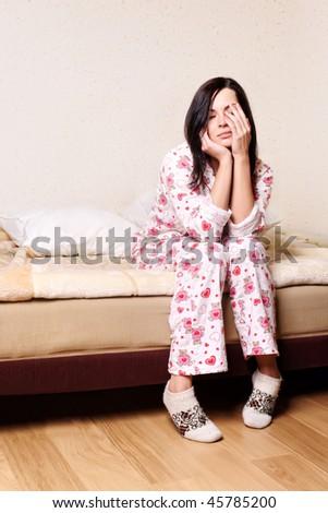 young beautiful brunette woman waking up - stock photo