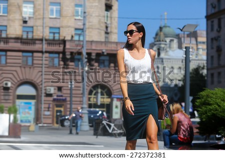 Young beautiful brunette woman with a bag in his hand