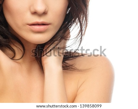 Young beautiful brunette woman with make-up isolated on white background - stock photo