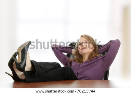 Young beautiful business lady having a rest at the working place.
