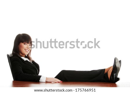 Young beautiful business lady having a rest at the working place. Isolated.  - stock photo