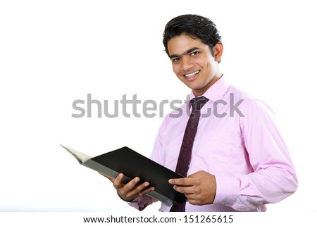 Young beautiful business man holding file in office.