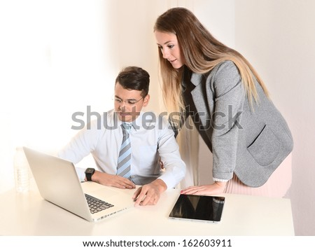 Young  beautiful Business Woman and handsome Man working together on computer at office - stock photo