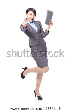 Young beautiful business woman happy using tablet pc and show thumb up in full length isolated on white background, model is asian beauty - stock photo