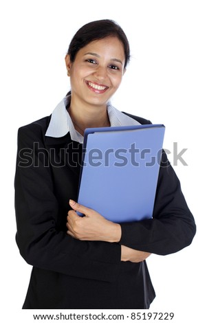 Young beautiful business woman holding file - stock photo