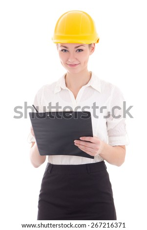 young beautiful business woman in builder helmet with clipboard isolated on white background