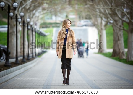 Young beautiful business woman, outdoors portrait