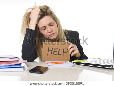 young beautiful business woman suffering stress working at office computer desk asking for help feeling tired and desperate looking overworked pulling her hair overwhelmed and frustrated - stock photo