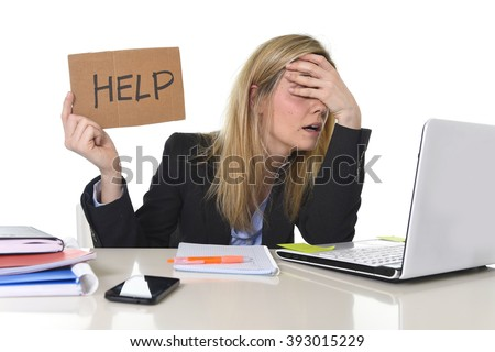 young beautiful business woman suffering stress working at office computer desk asking for help feeling tired and desperate looking overworked covering eyes overwhelmed and frustrated - stock photo