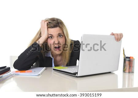young beautiful business woman suffering stress working at office computer desk feeling tired and desperate looking overworked overwhelmed and frustrated in mess and chaos - stock photo
