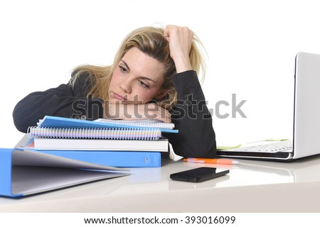 young beautiful business woman suffering stress working at office computer desk load of paperwork feeling tired and desperate looking overworked overwhelmed and frustrated