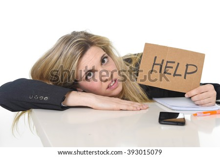 young beautiful business woman suffering stress working leaning sad on office desk asking for help feeling tired and desperate looking overworked overwhelmed and frustrated - stock photo