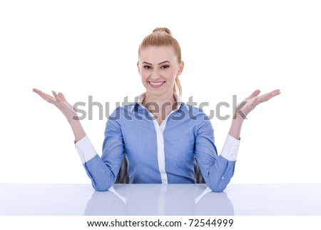 Young beautiful business woman welcoming behind the desk, isolated - stock photo