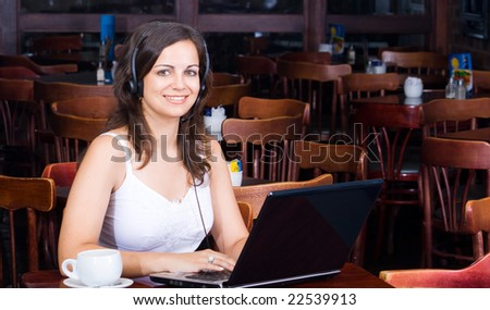 young beautiful business woman with headset