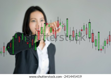 Young beautiful businesswoman drawing a graph - stock photo
