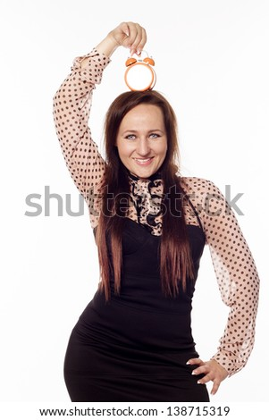 Young beautiful businesswoman holding a clock on her head - stock photo