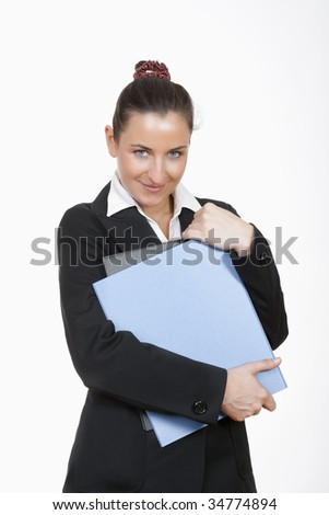 young beautiful businesswoman in suit standing holding files