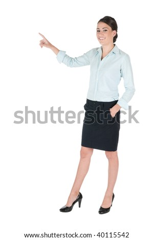 Young, beautiful businesswoman pointing at something, happy and smiling, isolated on white background