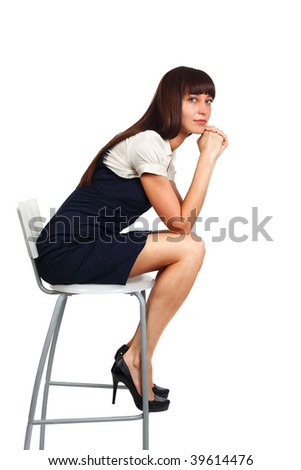 young beautiful businesswoman sitting on a chair studio shot on white - stock photo