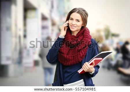 Young beautiful businesswoman talking on phone outdoors
