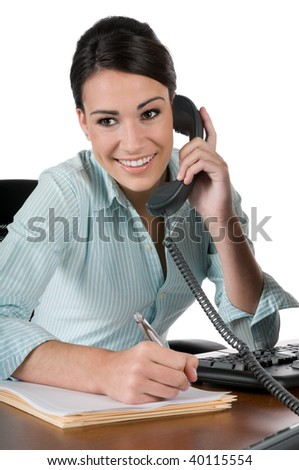 Young, beautiful businesswoman talking on the phone and taking notes at work, happy and smiling, isolated on white background