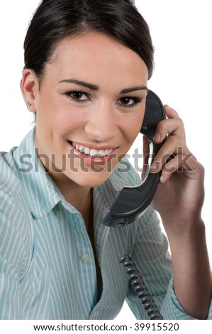 Young, beautiful businesswoman talking on the phone at work, happy and smiling, isolated on white background