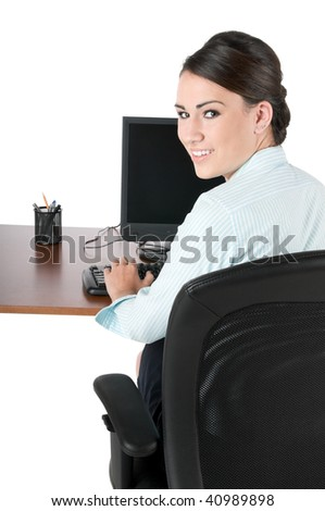 Young, beautiful businesswoman typing on computer keyboard at work, happy and smiling, isolated on white background - stock photo