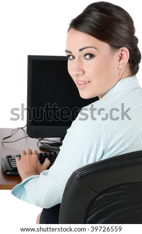 Young, beautiful businesswoman typing on keyboard at work, happy and smiling, isolated on white background - stock photo