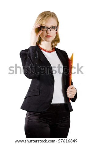 Young beautiful businesswoman with colored folders strong dressed is touching her glasses - stock photo