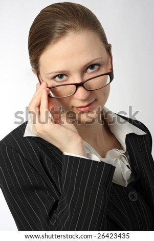 Young beautiful businesswoman with glasses on white background