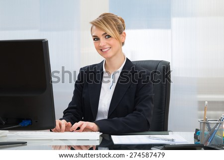 Young Beautiful Businesswoman Working On Computer In Office - stock photo