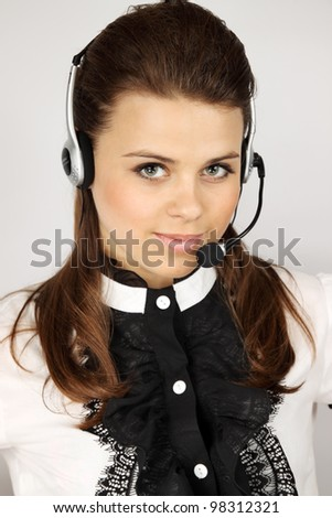 Young beautiful call center female operator portrait - stock photo