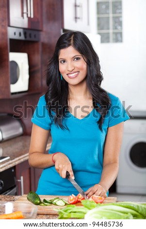 young beautiful casual woman cooking in kitchen - stock photo