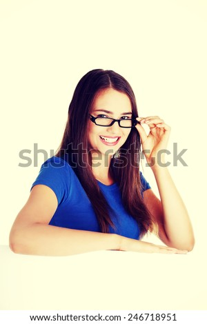 Young beautiful casual woman holding copy space. - stock photo