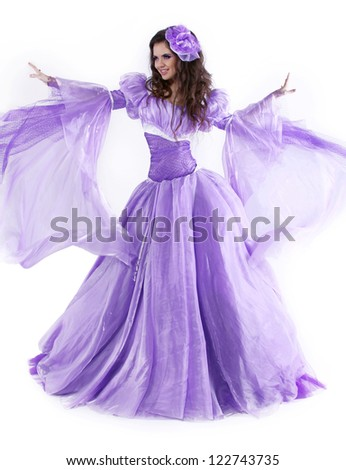 Young beautiful Caucasian brunette in gorgeous dress, motion shot - stock photo