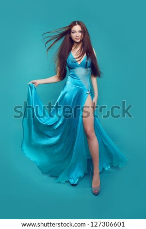 Young beautiful caucasian brunette in gorgeous dress, motion shot